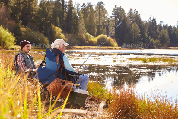 Father and adult son fishing lakeside, Big Bear, California - Stock Photo - Images