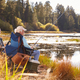 Father and adult son fishing lakeside, Big Bear, California - PhotoDune Item for Sale