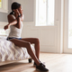 Young black woman stretching at home before exercising - PhotoDune Item for Sale
