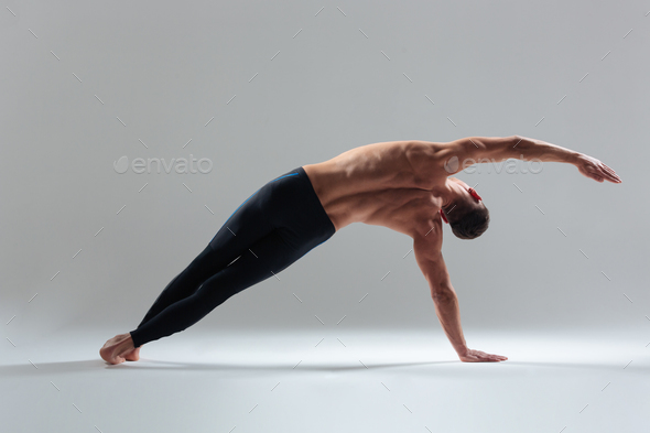 Full length portrait of a fitness man warming up - Stock Photo - Images
