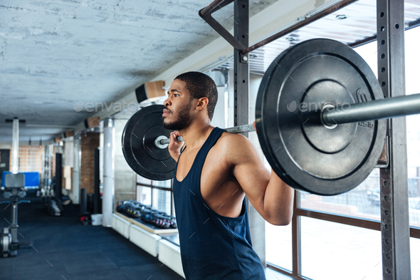Muscular Fitness Man Doing Heavy Exercise - Stock Photo - Images