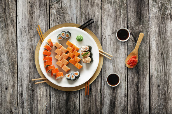 Set of sushi maki and rolls at rustic wood. - Stock Photo - Images
