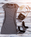 Striped dress and black purse.
