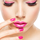 eautiful woman face with pink makeup of eyes and nails. - PhotoDune Item for Sale