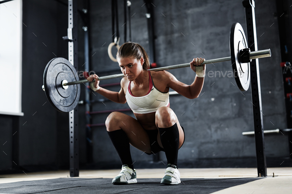 Lifting weight in gym - Stock Photo - Images