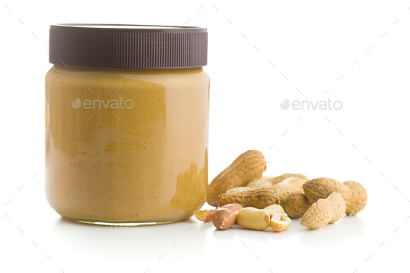 Creamy peanut butter and peanuts. - Stock Photo - Images