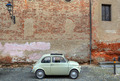 Retro car in front of ancient wall. - PhotoDune Item for Sale