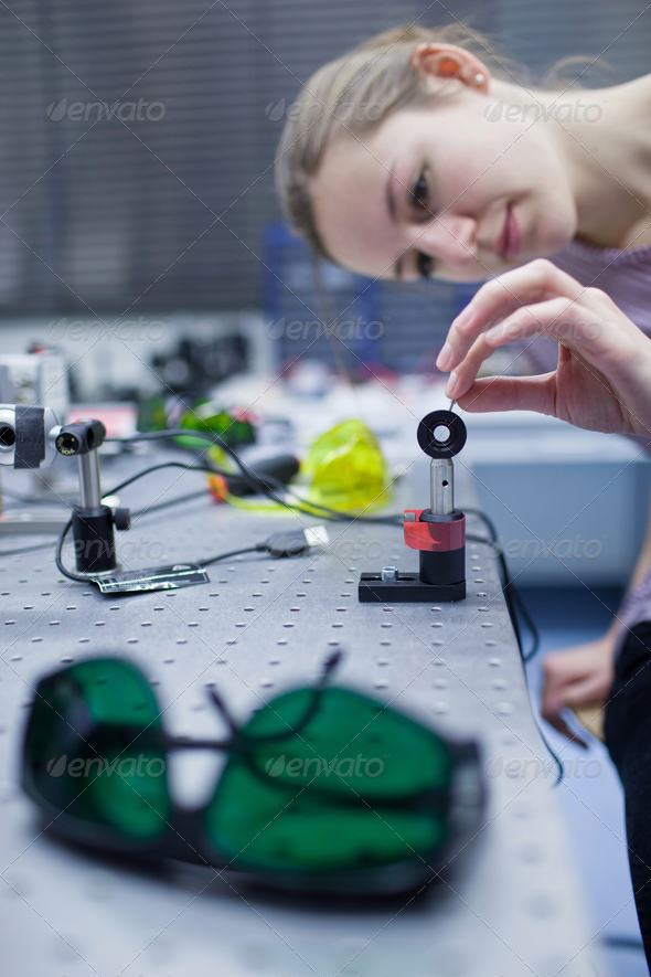 female scientist doing research in a quantum optics lab (color t - Stock Photo - Images