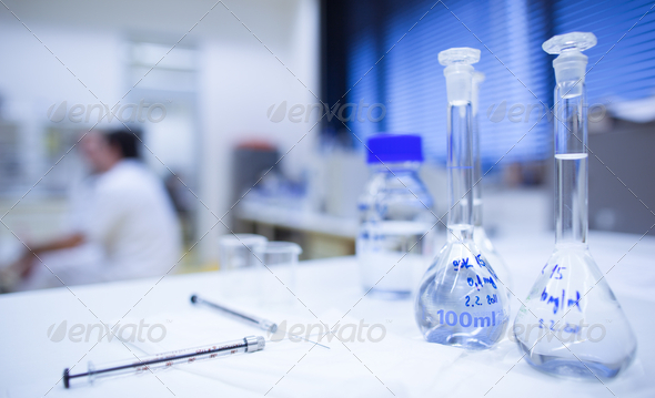 chemistry lab (shallow DOF; focus on the glassware in the foregr - Stock Photo - Images