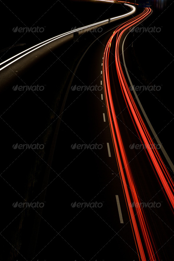 Cars moving fast on a night highway (motion blurred image) - Stock Photo - Images