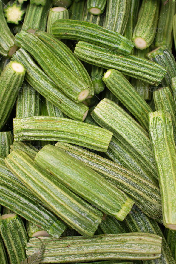 Fresh chopped Roman zucchinis on display at an Italian outdoors - Stock Photo - Images
