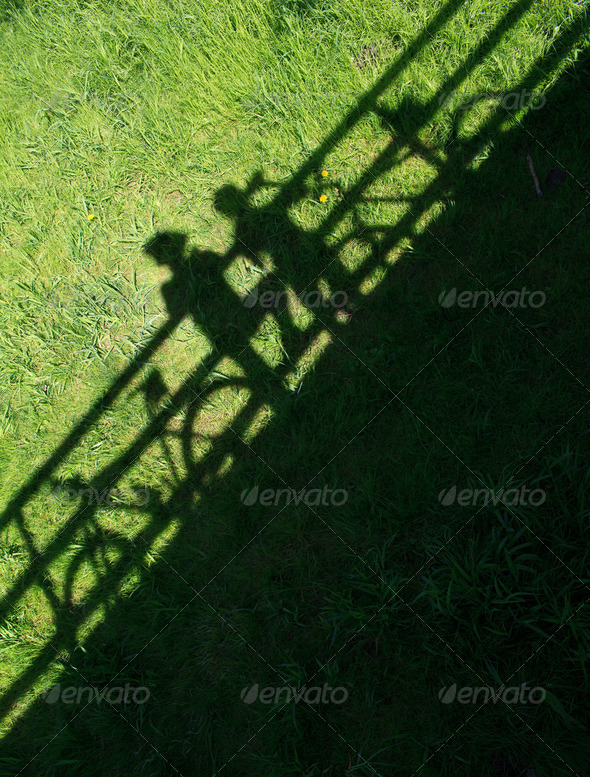 two mountain bikers' silhouettes during a halt on a bridge - Stock Photo - Images