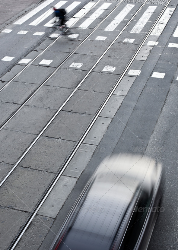 urban traffic concept - city street with a crossing, rail, motio - Stock Photo - Images