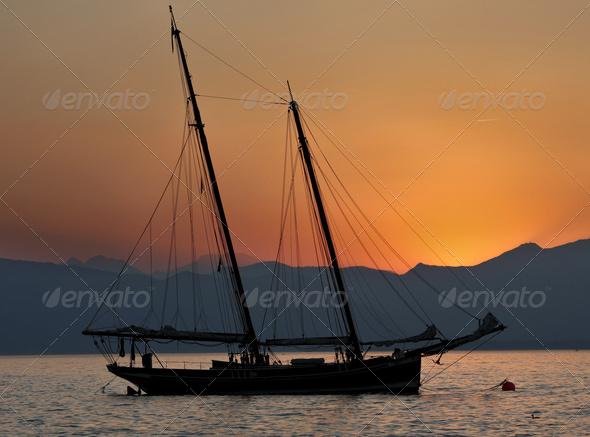 splendid sailboat at sunset - Stock Photo - Images