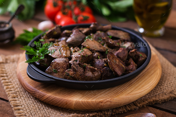Fried chicken liver with onions and herbs - Stock Photo - Images