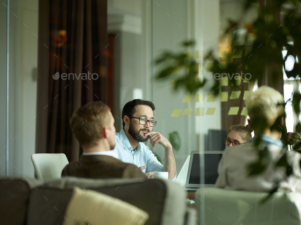Pensive worker at meeting - Stock Photo - Images