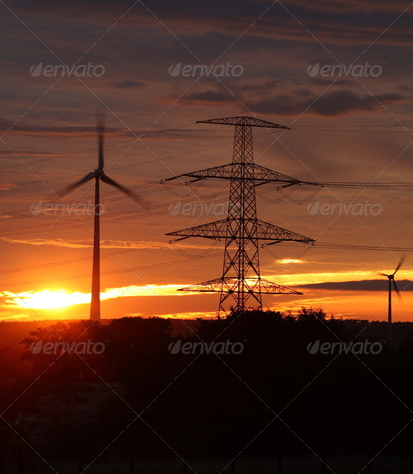 wind energy harvesting wind mills at sunrise - Stock Photo - Images