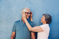 Woman adjusting the eyeglasses on her husband - PhotoDune Item for Sale