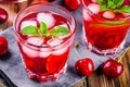 cherry lemonade with ice and mint in glasses