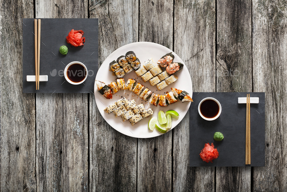 Set of sushi maki and rolls at black rustic wood. - Stock Photo - Images