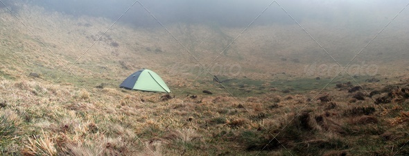 Tent on a misty morning - Stock Photo - Images