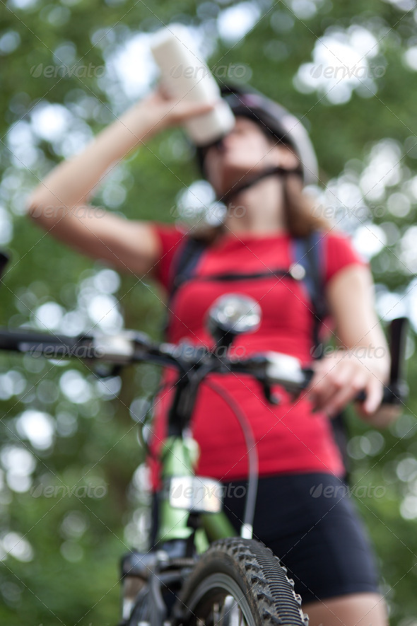 pretty young female biker outddors on her mountain bike (shallow - Stock Photo - Images