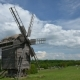 Old Windmill In The Background, Clouds Float. - VideoHive Item for Sale