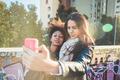 Multiethnic women taking selfie - PhotoDune Item for Sale