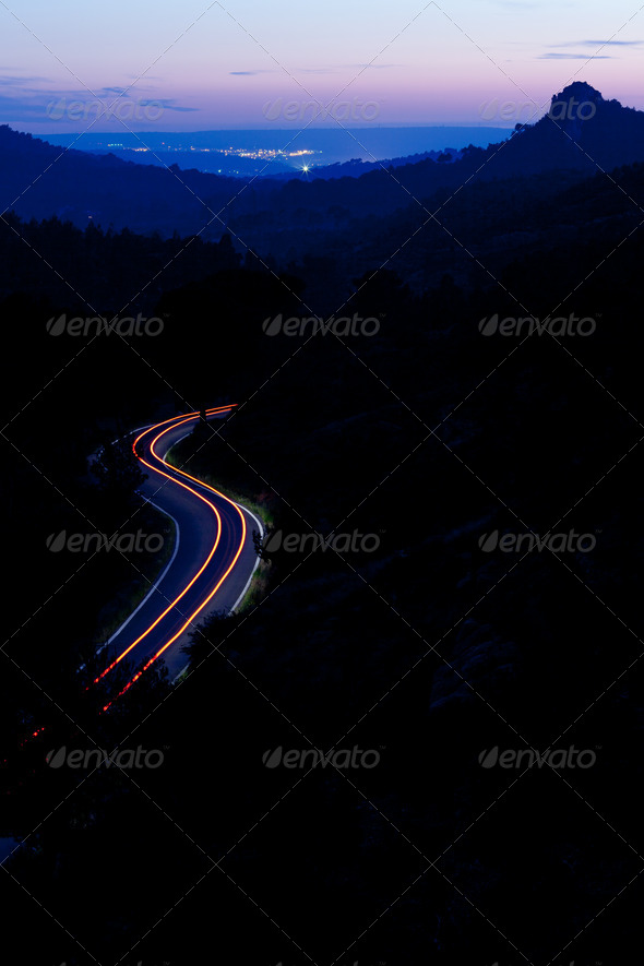 mountain road at night with cars moving fast (color toned image) - Stock Photo - Images