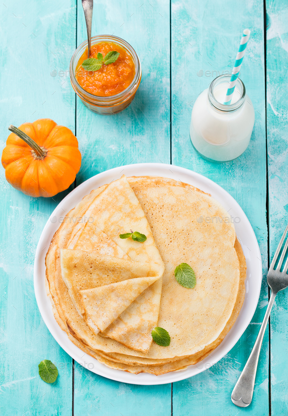 Thin crepes or pancakes with fresh pumpkin confiture, jam - Stock Photo - Images