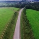 Aerial View Of Unlimited Space Of Forest Plain And Cars Which Are Riding On Highway. Nulled