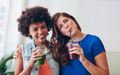 Beautiful women drinking fresh juice together
