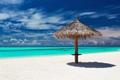 Single tropical beach umbrella on romantic white beach - PhotoDune Item for Sale