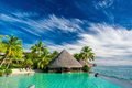 Infinity pool with artificial beach and bar next to tropical oce - PhotoDune Item for Sale