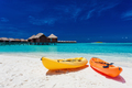 Yellow and orangel kayaks on the tropical beach with vilas - PhotoDune Item for Sale