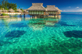 Villas in the lagoon with steps into shallow water with coral - PhotoDune Item for Sale