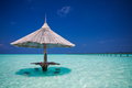 Bamboo beach umbrella with bar seats in the water - PhotoDune Item for Sale