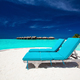 Two blue chairs on sandy island overlooking stunning tropical be - PhotoDune Item for Sale
