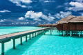 Overwater villas on the tropical lagoon with jetty - PhotoDune Item for Sale