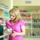 Seller In The Store Helps Girl To Choose Engine Oil. - VideoHive Item for Sale