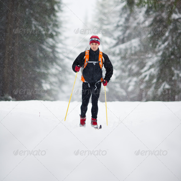 Cross-country skiing: young man cross-country skiing on a lovely - Stock Photo - Images