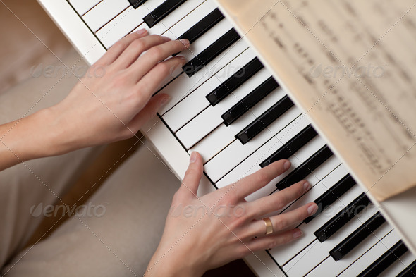 Playing Piano (shallow DOF; color toned image) - Stock Photo - Images