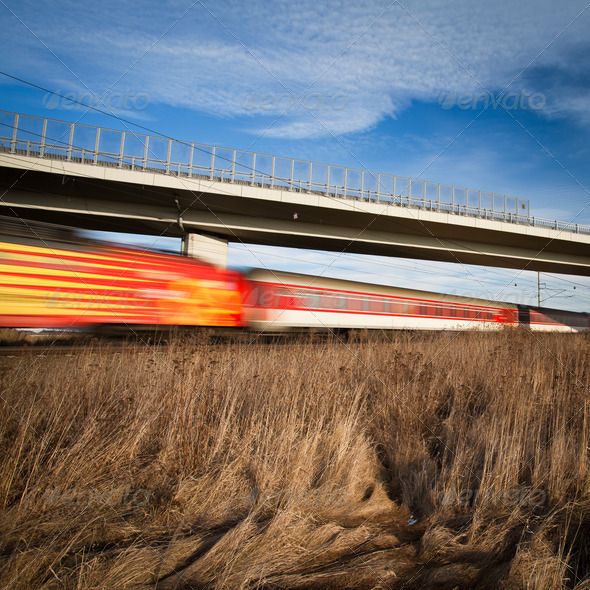 Fast train passing under a bridge on a lovely summer day (motion - Stock Photo - Images