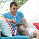 Young Man Uses Tablet Outdoors - VideoHive Item for Sale
