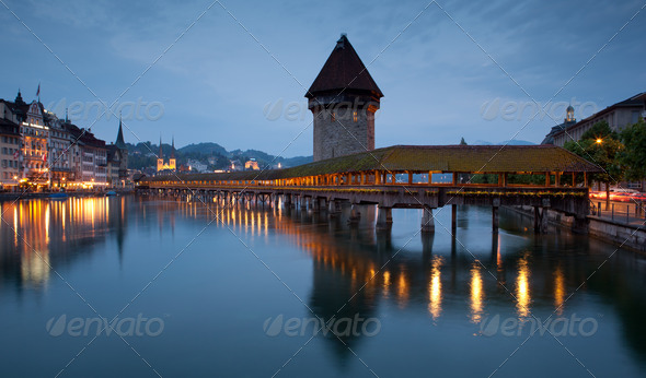 Famous covered wooden footbridge in Lucerne, Switzerland - Stock Photo - Images