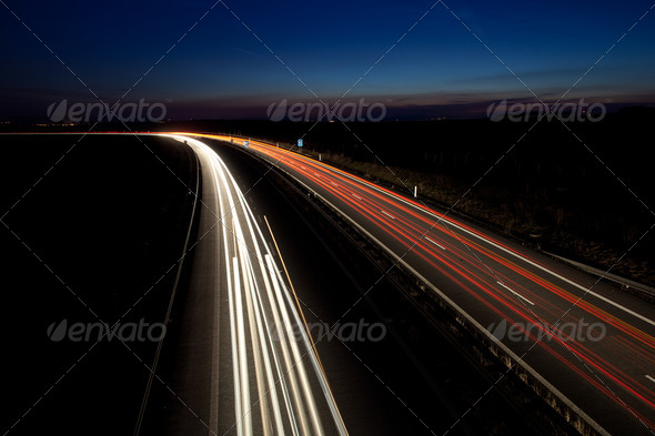 Cars moving fast on a highway - Stock Photo - Images