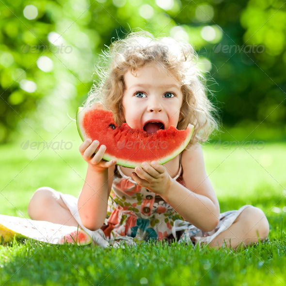 Child having picnic in park - Stock Photo - Images