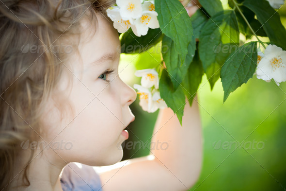 Child with jasmin flower - Stock Photo - Images