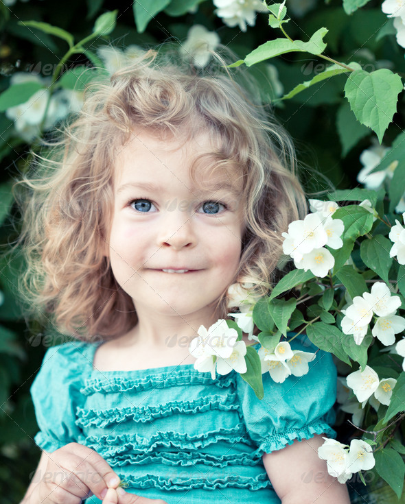 Beautiful child with flower - Stock Photo - Images