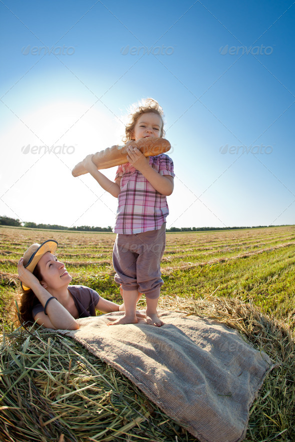 Happy woman and child in wheat field - Stock Photo - Images